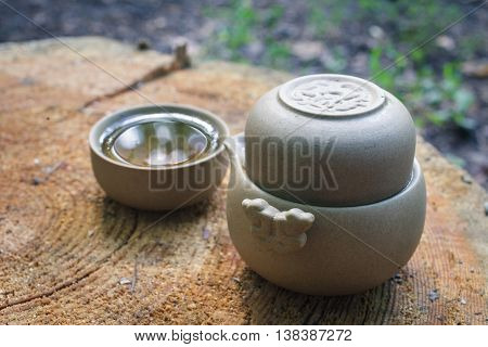 Tea Set Outdoors On A Wooden Stump