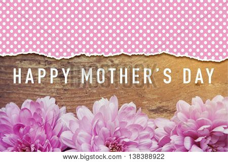 pink flowers on wooden with word Happy Mother's Day