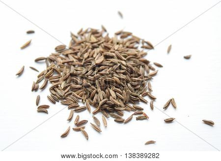 Pile of caraway seeds used in Eastern European Middle Eastern and Indian cuisine. Related to carrot family.