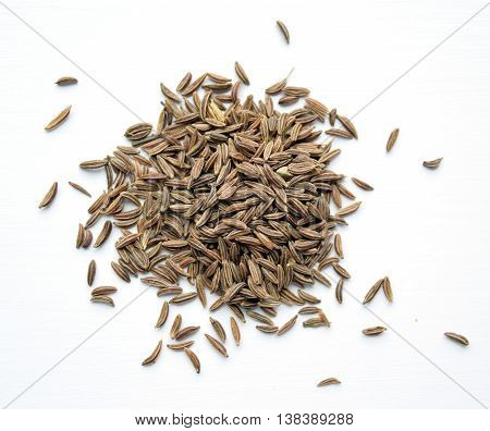 Pile of organic caraway seeds used in Eastern European Middle Eastern and Indian cuisine. Related to carrot family.