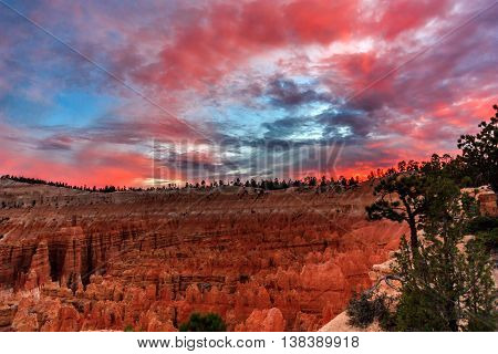 Red cloudy sky over Bryce Canyon after sunset