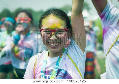 Chengdu Sichuan province China - July 2 2016: Runners having fun at the Color Run China in Chengdu