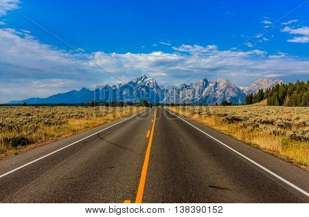 A deserted highway to Grand Teton National Park