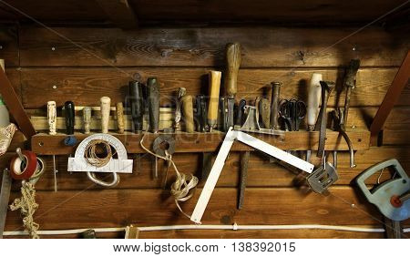 Various tools related to homework on wooden background