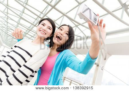 Excited women taking photo together