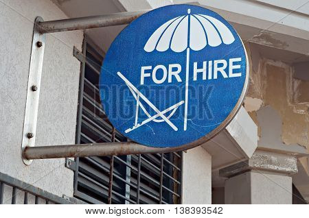 Sign advertising beach chairs and umbrellas for hire
