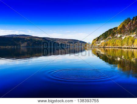Horizontal Vivid Norway Day River Water Circles Drops Background