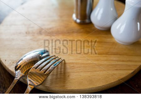 Spoon and Fork Tied on the wooden table