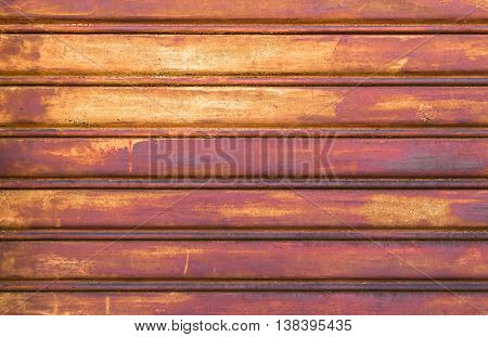 Close-up metallic pattern of rusty gate for background.