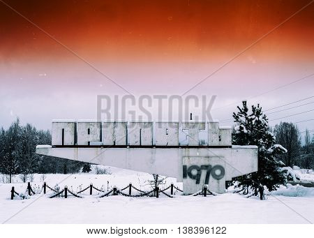 Horizontal vivid orange vintage radioactive Pripyat town sign background backdrop