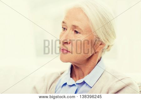 age, emotion, sadness and people concept - senior woman face at home