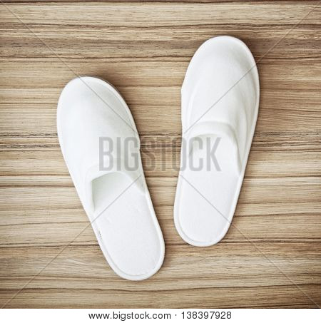 White slippers on the wooden texture. Beauty and fashion. Retro style.