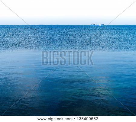 Horizontal vivid ocean horizon distant ship background backdrop