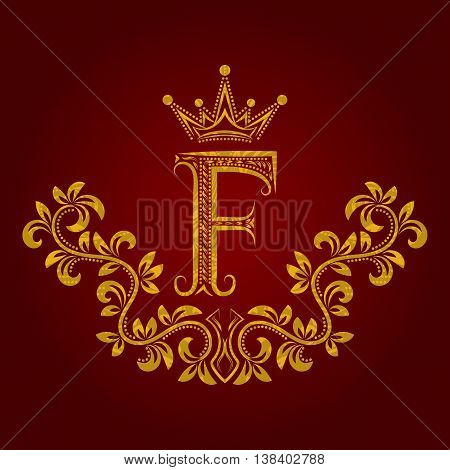 Patterned golden letter F monogram in vintage style. Heraldic coat of arms. Baroque logo template.