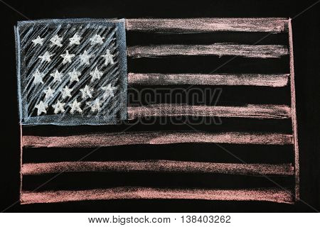 Child's chalk drawing of American flag on blackboard