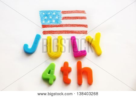 Child's drawing of American flag and plastic letters