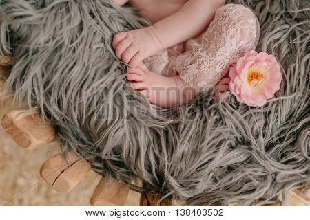 woolen blanket on the legs and handles in a baby pink lace