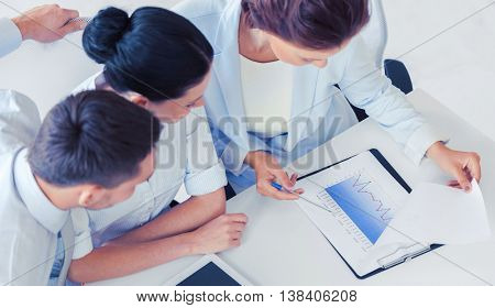 business, school and education concept - friendly business team having discussion in office