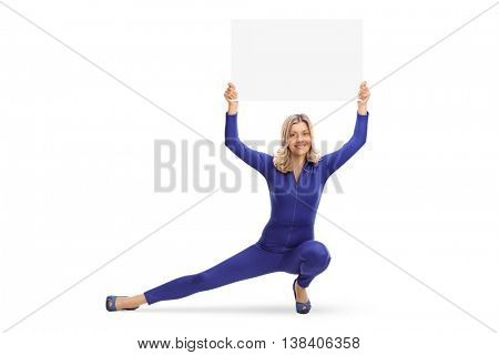 Woman in a blue one-piece costume holding a banner over her head and crouching isolated on white background