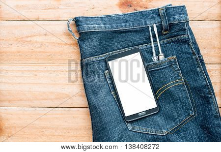 The Jeans With Mobile Phone And Screwdriver Tool In Pocket On Wooden Board