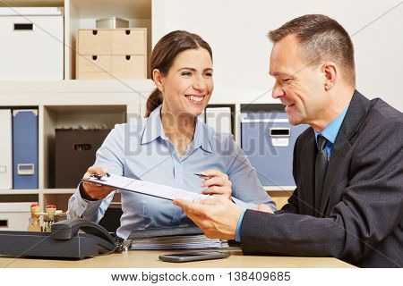 Business man signing contract after negotiation in office