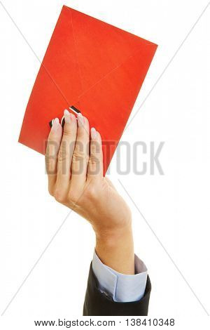 Hand holding up a red letter as symbol for communication