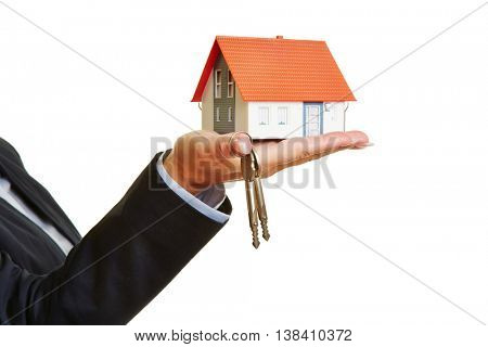 Hand holding house and keys as concept for real estate financing