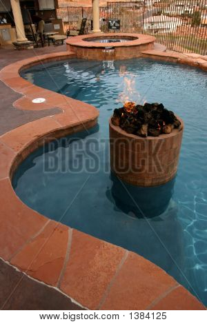 A Custom Firepit Enhances A Pool In Southern Utah