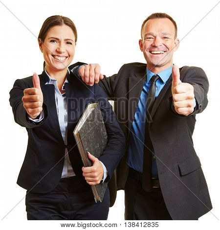 Happy successful business team holding their thumbs up
