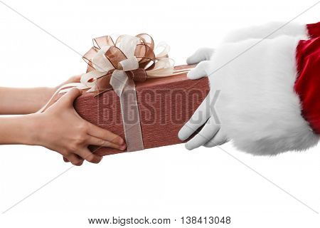 Santa hands give present to kid, isolated on white