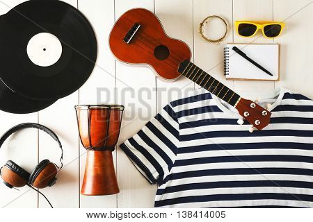 Musician set on white wooden background