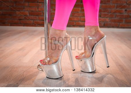 Woman sexy shoes for pole dance closeup.
