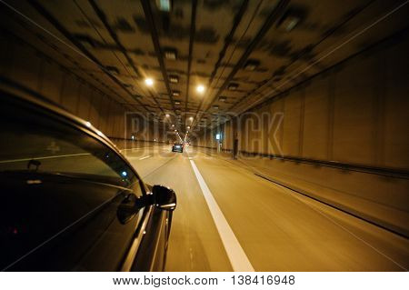 View From The Car Window, Car Moving Through The Tunnel At Light.