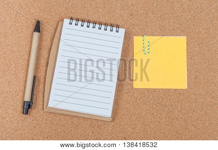 book note and shot note on cork board