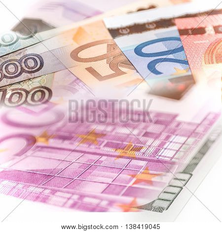 US Dollars, Russian Roubles and Euro banknotes compilation, close up
