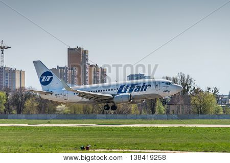 Kyiv Ukraine - April 26 2015: Boeing 737-500 UTair Aviation landing in the Kyiv International Airport Zhuliany (IEV) Ukraine at April 26 2015. UTair Aviation is an airline with its head office at Khanty-Mansiysk Airport in Russia.