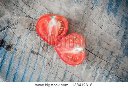 Tomatoes on a wooden board. Tomatoes and cucumbers. Vegetables on a wooden table. Green.