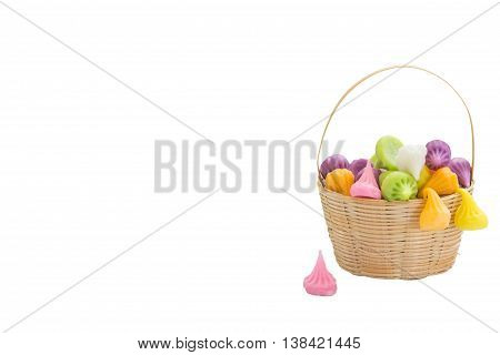 Dessert turnovers color in the basket isolated on white background. card space