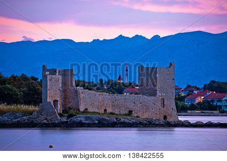 Island of Vir dawn view fortress and Velebit mountain Dalmatia Croatia