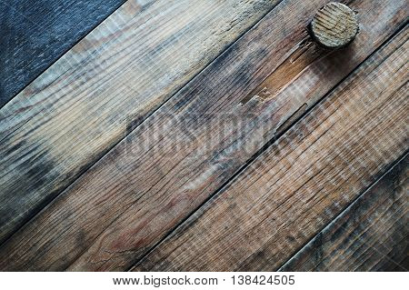 Grunge wooden background with a cork. Cover wine barrel close-up.