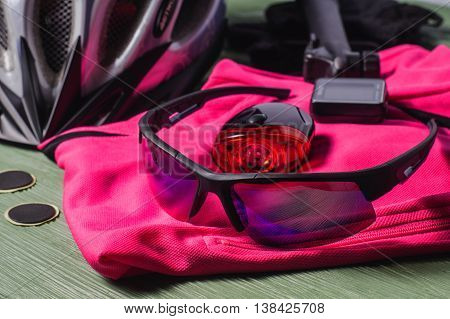 Items replacements and tools for a safe cycling: Helmet gloves glasses pump patches. Sport equipment sports uniform. Tools and accessories set for cycling.