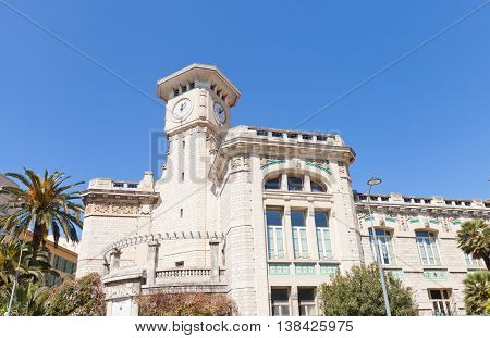 NICE FRANCE - APRIL 11 2016: Clock Tower of Lycee Massena in Nice France. Lycee Massena houses in a former convent of Augustinians erected in 1623 current view since 1909