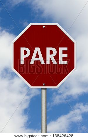 Stop Sign in Spanish Pare Sign Red and white Stop Sign with word Pare with sky background, 3D Illustration