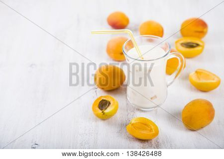 Apricot Smoothie On A Wooden Table