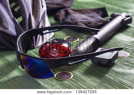 Items replacements and tools for a safe cycling: Helmet gloves glasses pump patches. Tools and accessories set for cycling.