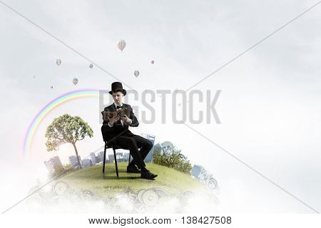 Businessman in cylinder reading book . Mixed media