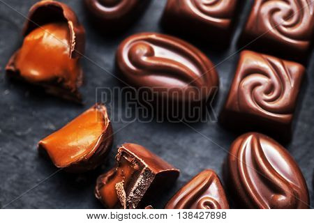 Luxury chocolate candies. Top view image. Black chocolate praline