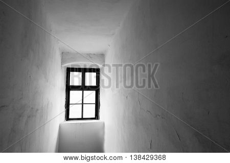 Narrow Space With One Antique Window. Scary Black And White Background