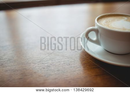Close-up of fresh frothy coffee served on table at cafeteria