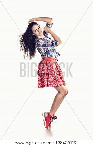 modern style hip-hop dancer posing on studio background